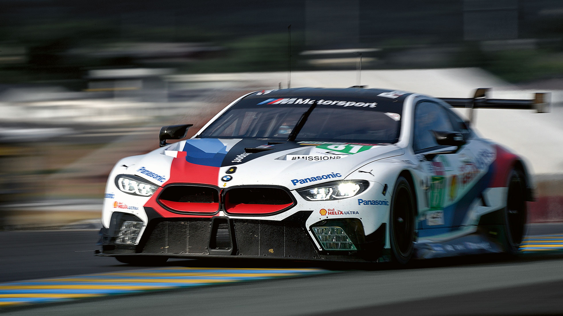 The picture shows the front of a BMW race car.