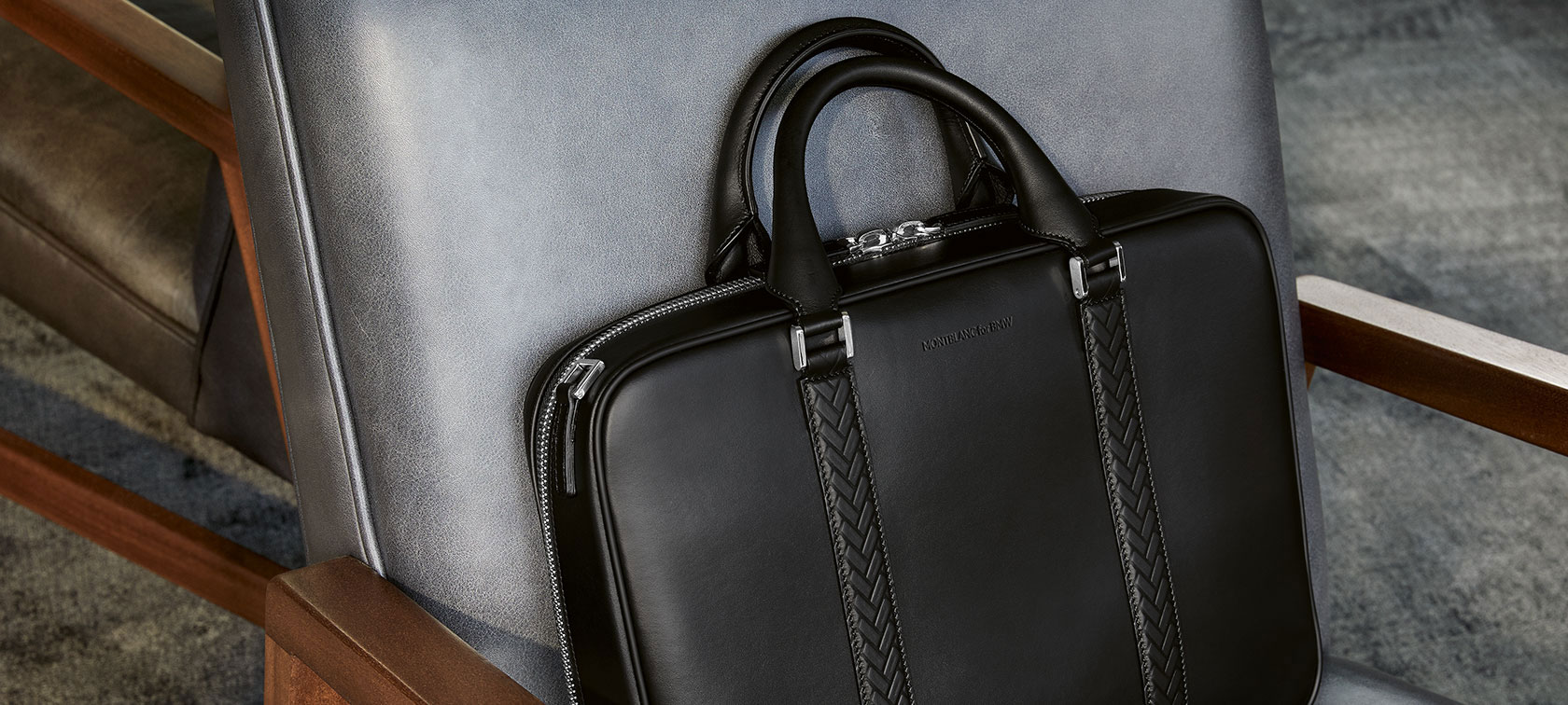 The picture shows the Montblanc for BMW Document Bag lying on a chair.