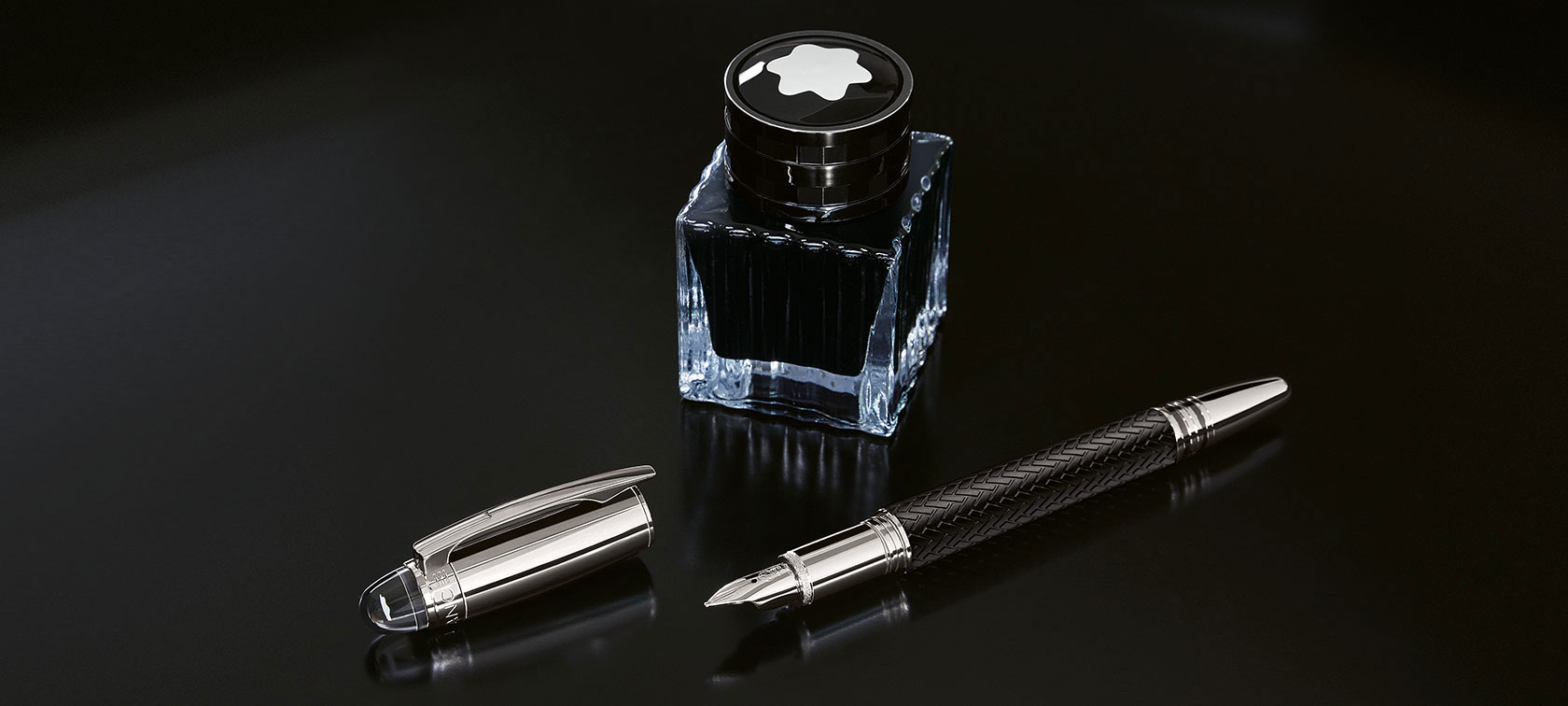 The Montblanc for BMW Fountain Pen is seen lying in front of the Montblanc for BMW Ink Bottle.