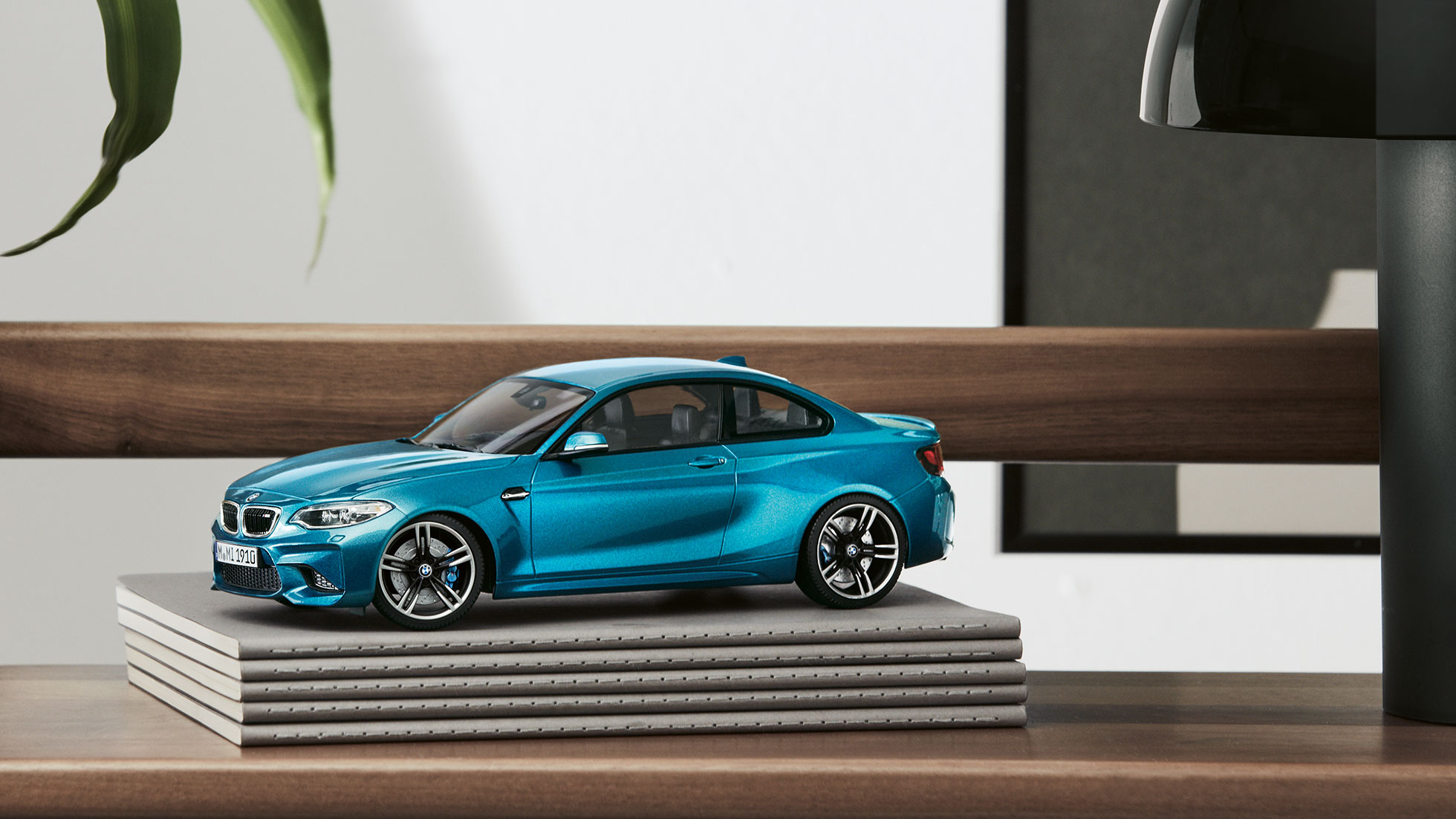 The picture shows a miniature of the BMW M2 in Long Beach Blue.