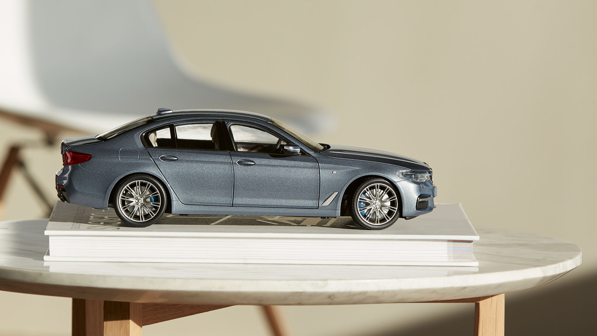 The picture shows a Miniature BMW 5 Series in the colour Sophisto Grey.